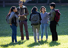 small group of students converse at mission bay campus event